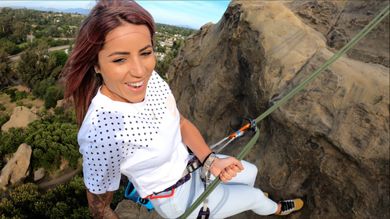 Leticia Bufoni rock climbing in the Flow State episode she joins Dylan Efron on.